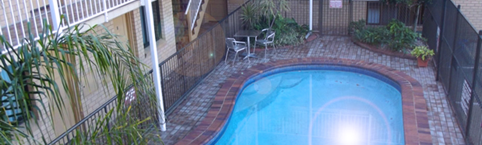 Relax by the swimming pool at Chermside Motor Inn
